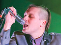"A filmmaker has branded his business dealings with Arcade Fire as ""disgusting""."