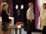 Glenda arrives at the club in a businesslike mood to meet Phil and Shirley.
