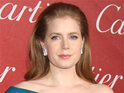 Amy Adams celebrates her Oscar nomination by spending the day with the Muppets.