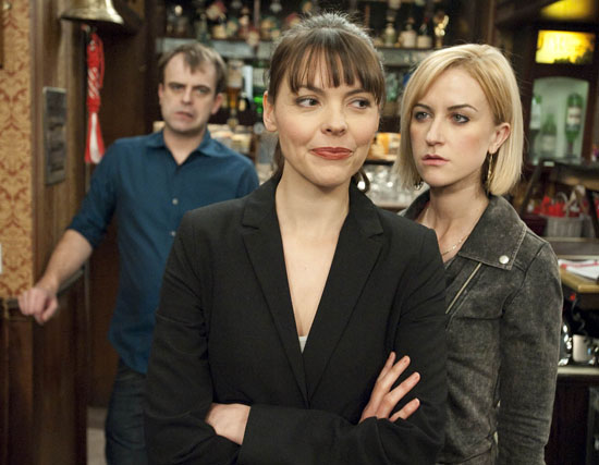 Tracy Barlow (Kate Ford) behind the bar at The Rovers with Steve McDonald (Simon Gregson) and Becky McDonald (Katherine Kelly)