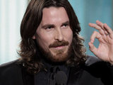 Christian Bale picks up his 'Best Supporting Actor' gong for 'The Fighter'.