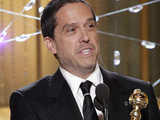 To infinity… and beyond! Lee Unkrich with 'Toy Story 3's Golden Globe.