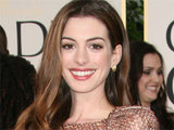 Anne Hathaway is all smiles on the red carpet of the 68th Annual Golden Globe Awards