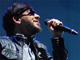 Mike Shinoda of Linkin Park performing with the band in Chicago, Illinois