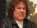 Thin Lizzy guitarist Gary Moore died of a heart attack according to an initial post mortem report.