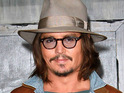 Johnny Depp says that his son prefers Iron Man to Captain Jack Sparrow.