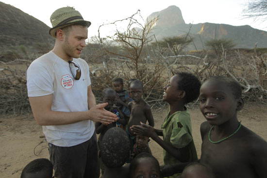 Olly Murs with local children
