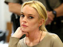 Lindsay Lohan reportedly hides in a closet while her father allegedly tries to break into her home.