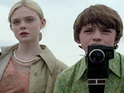 Super 8 star Elle Fanning praises director J.J. Abrams for taking care of the film's young cast.