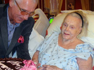 Frederic Prinz von Anhalt delivers a birthday cake to his 94-year-old wife Zsa Zsa Gabor