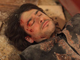 Syed is lying injured on the floor in the Argee Bhajee.