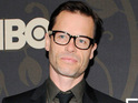 Guy Pearce admits that it was difficult to tell his wife about the sex scenes in Mildred Pierce.