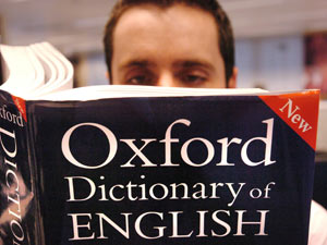 A man reading the Oxford English Dictionary