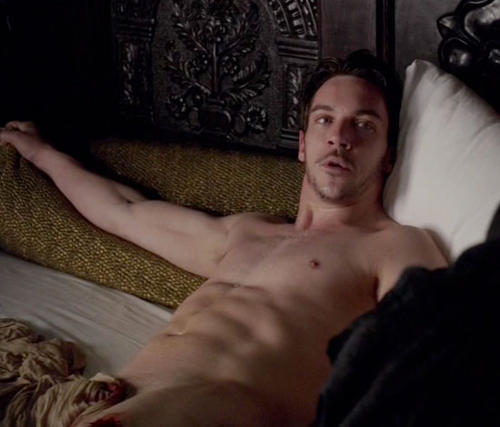 Jonathan shirtless in bed
