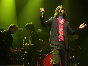 Glen Matlock and Bobby Gillespie perform with Primal Scream