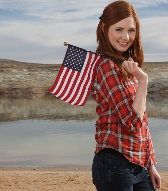 Amy poses with an American flag