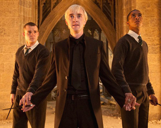 Draco Malfoy flanked by Gregory Goyle and Blaise Zabini
