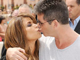Simon Cowell and Paula Abdul kiss at the first day of X Factor USA auditions