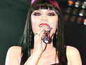 Jessie J cheers up crowds at Glastonbury festival today following an improvement in the weather.