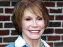 Mary Tyler Moore injures her face in a tumble after tripping over her dog.