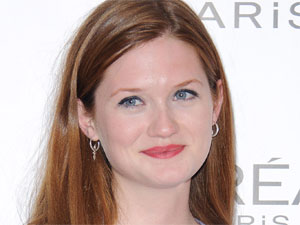 'Harry Potter' star Bonnie Wright showing off the awards the flick won in the press room of the National Movie Awards