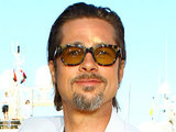 Brad Pitt attends a photocall for his new movie The Tree of Life on day 6 of the Cannes International Film Festival