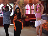 At the Argee Bhajee Tamwar and boys spy on Afia's dance routine.
