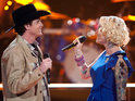 Curtis Grimes and Emily Valentine kiss at the end of their The Voice performance.