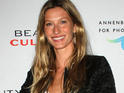 Gisele Bundchen sported a baby bump while on the beach last week.