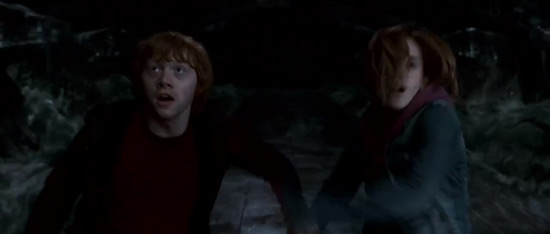 Ron and Hermione flee the Chamber of Secrets.
