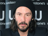 Keanu Reeves attends a book signing at a Waterstones store in Piccadilly, London