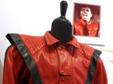 A red and black leather jacket worn by Michael Jackson in the 'Thriller' video sells for $1.8m (£1.1m), exceeding its estimate.