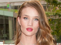 Rosie Huntington-Whiteley jokes that she found it hard not to succumb to Shia LaBeouf's charms.
