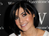 Kym Marsh signs copies of her new book 'From The Heart' at a Waterstone's store in Wigan, England