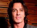 Rick Springfield jokes that he wants to go back to jail just to take another mugshot.