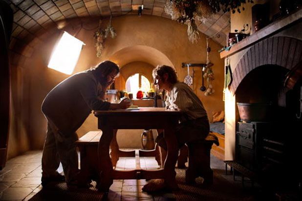 Director Peter Jackson consults with Martin Freeman on set.