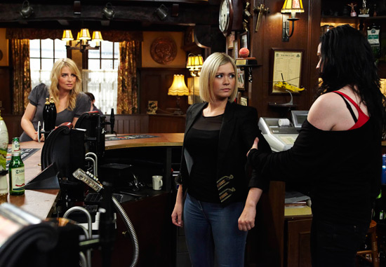 Chas enters the pub to see Eve behind the bar