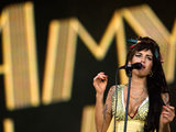 Amy Winehouse performs at the Rock in Rio music festival in Arganda del Rey, Spain, 2008.