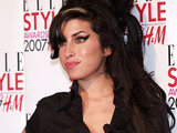 Amy Winehouse holds her Best British Music Act award, during the Elle magazine awards in London, 2007.