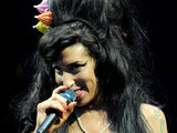 Amy Winehouse performing on the Pyramid Stage at the Glastonbury Festival 2008.