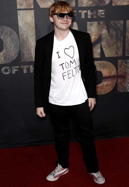 Rupert Grint wearing an &#39;I Heart Tom Felton&#39; t-shirt at the premiere of &#39;Rise oF the Planet of the Apes&#39;