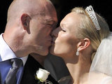 Zara Phillips and her new husband Mike Tindall kiss outside Canongate Kirk in Edinburgh.