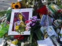 Take a look at the many messages of condolence left outside Amy Winehouse's Camden home.