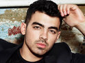 Joe Jonas admits that he still occasionally misses his brothers when performing live.