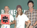 The Red Hot Chili Peppers perform for fans from a rooftop for their new music video.