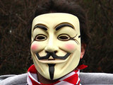 A man in a V for Vendetta mask