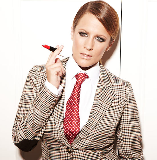 Caroline Flack posing for Heat Magazine