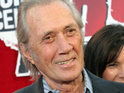 David Carradine's widow Anne drops a suit against a French film company over her husband's 2009 death.