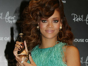 Rihanna is pictured during a photocall to launch her fragrance Reb'l Fleur, at House of Fraser on Oxford Street, London