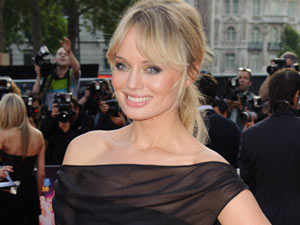 Laura Haddock strikes a pose on the red carpet.